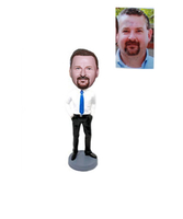 Man In White Shirt With Blue Tie Bobblehead Hands In Pockets