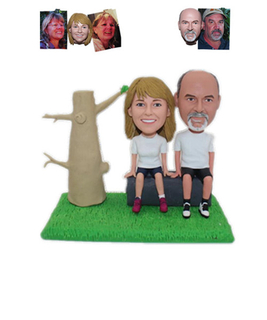 Customized Bobblehead Couple Sitting on A Stone Next To A Tree